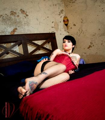 Edits of Bettie in stockings on a bed.