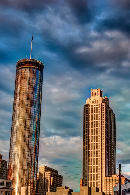 high rise buildings with storm clouds at sunset.