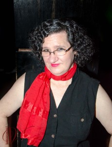Wendi in bright red scarf.