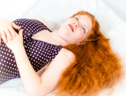 Redhead in Polkadot One-piece.